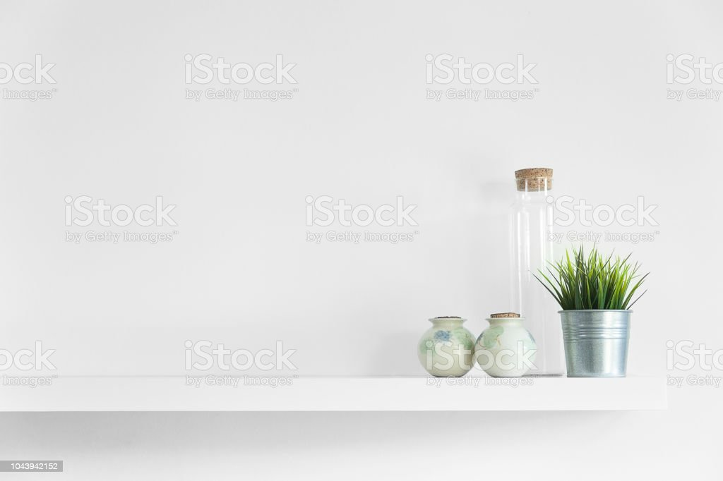 interior home decor floating shelf with plants bottles and various items gm