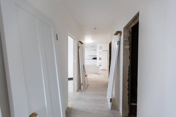 Interior in a new apartment without repair with white door stock photo