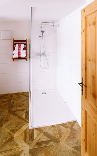618327092 istock photo Interior in modern white bathroom with wood design shower 1139715399