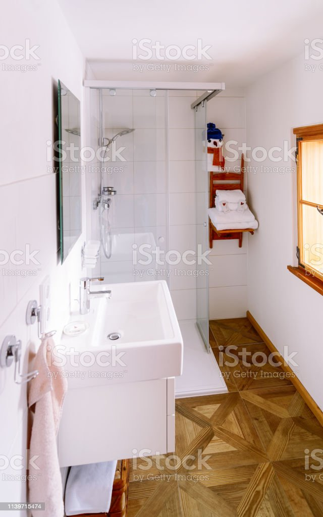 Interior in modern white bathroom with wood design. Home with mirror,...