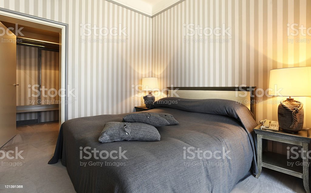 interior luxury apartment, comfortable bedroom royalty-free stock photo