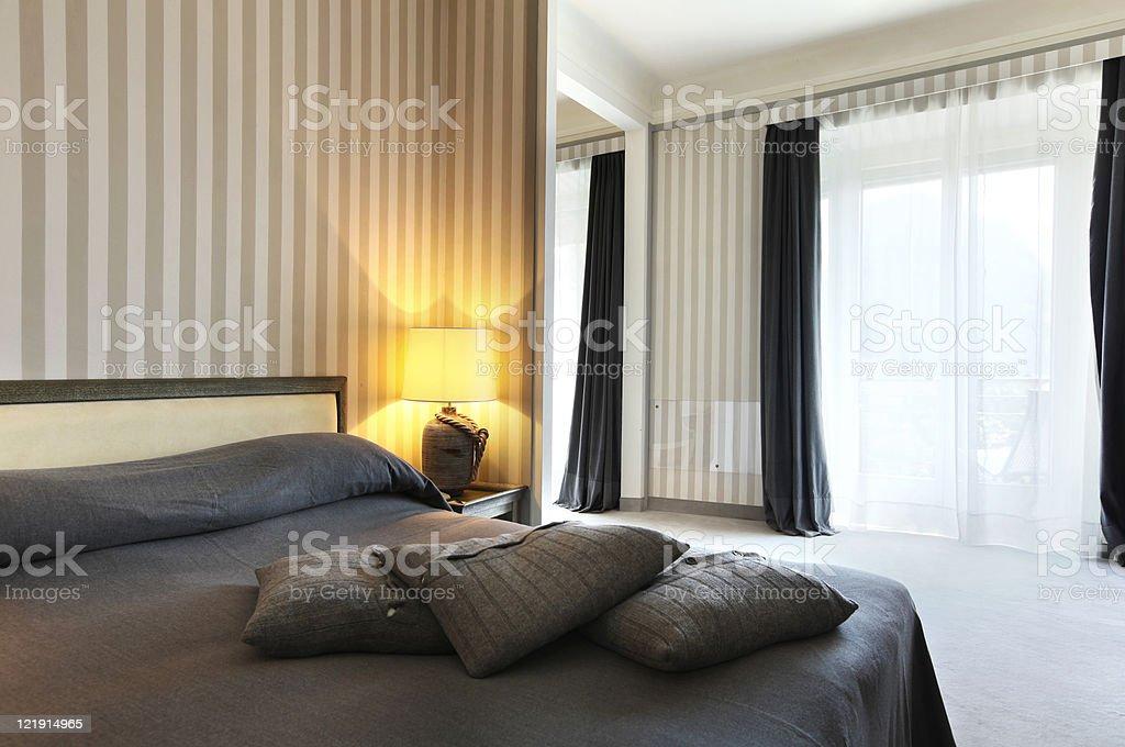 interior luxury apartment, comfortable bedroom royalty-free stock photo