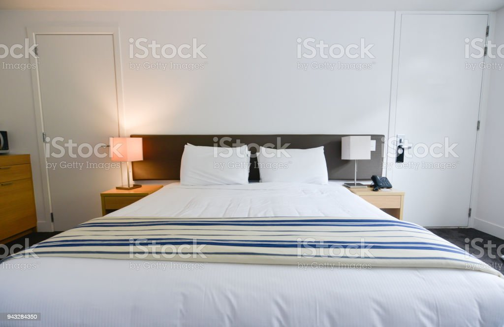 Interior luxury bed in the hotel stock photo