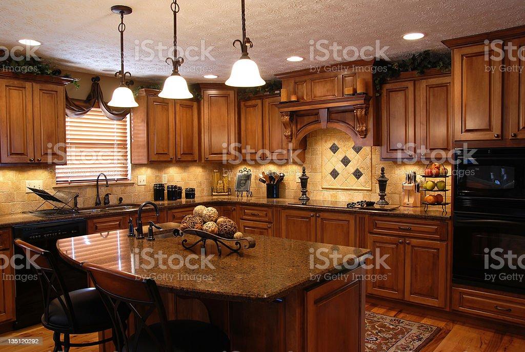 Interior of a beautiful custom kitchen A beautiful interior of a custom kitchen Appliance Stock Photo