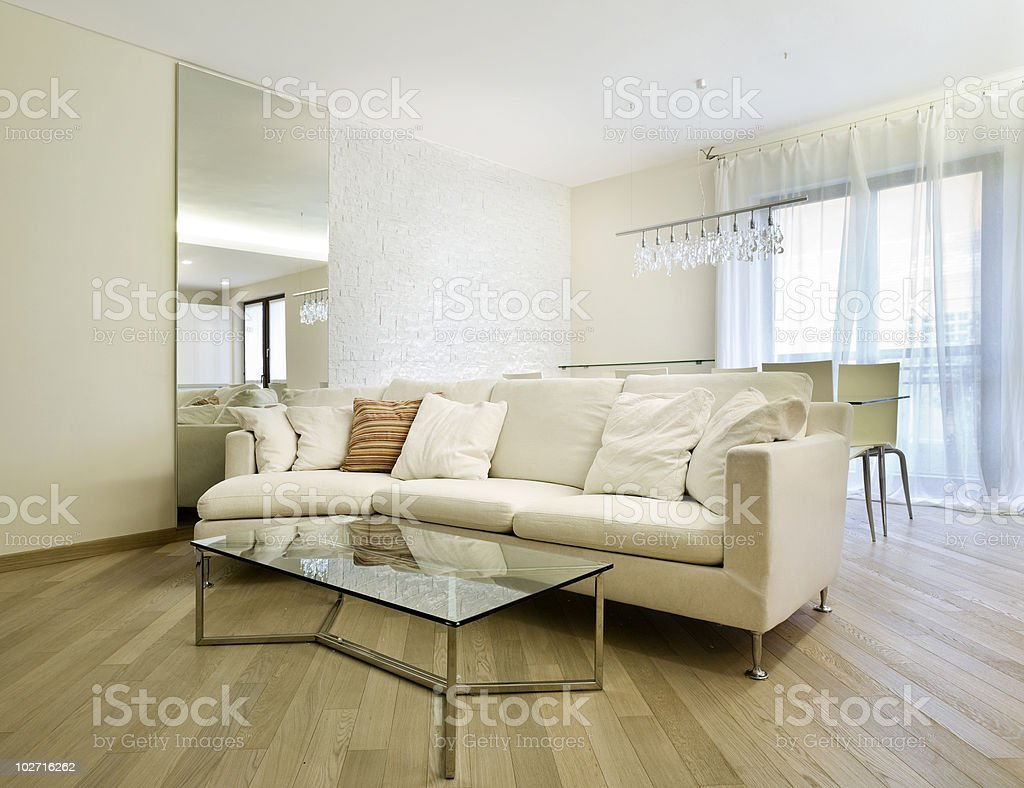 Interior of a beautiful house decorated in beiges royalty-free stock photo
