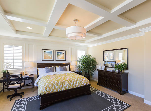 Interior of A Beautiful Master Bedroom Dramatic Interior of A Beautiful Master Bedroom. bedroom stock pictures, royalty-free photos & images