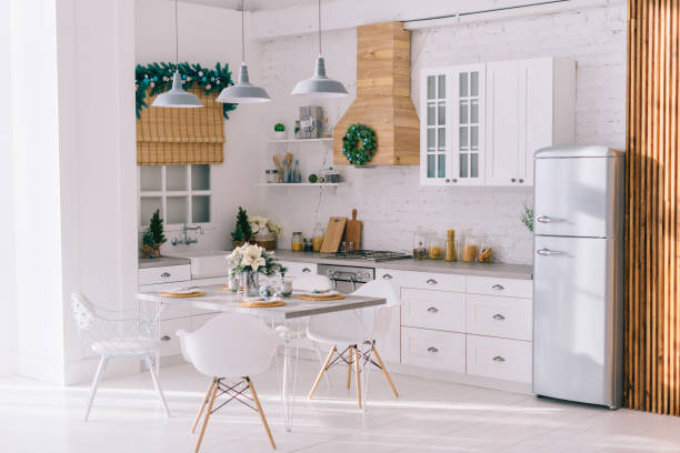 Interior of a bright modern kitchen in vintage style, decorated with Christmas decor stock photo