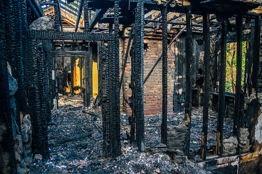 istock Interior of a burnt by fire apartment in an apartment building. Burned wooden beams 865944582