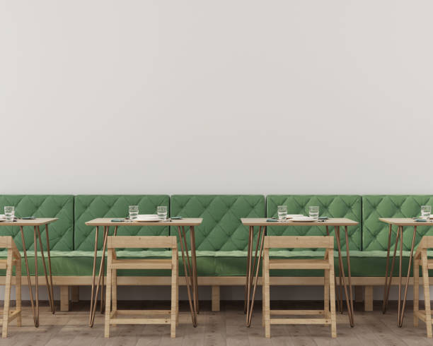 Interior of a cafe or restaurant with a soft green sofa