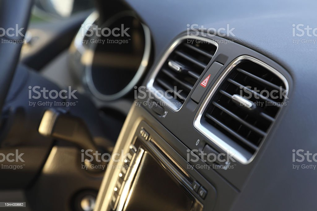 Interior of a car showing the air conditioner system stock photo