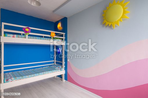 Interior of a children's room for two girls after repair, painted wall and bunk bed