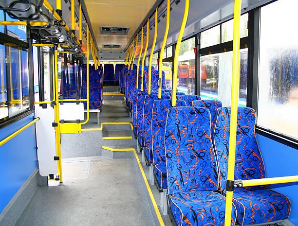 innenraum eines city bus - eingangshalle wohngebäude innenansicht stock-fotos und bilder