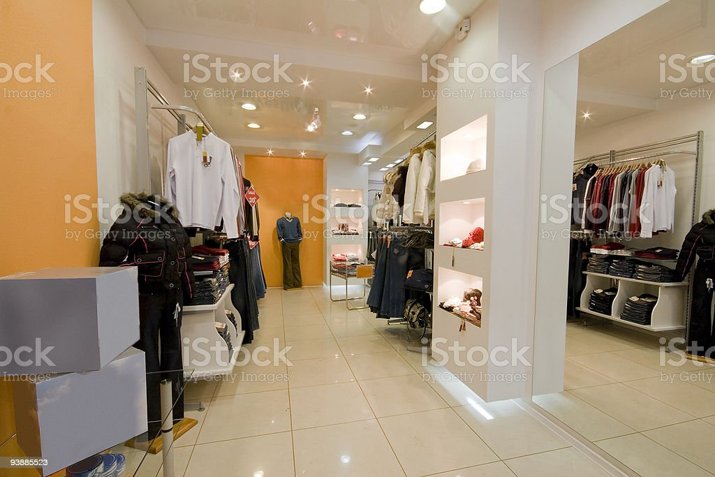 Interior of a clothes shop with orange walls stock photo