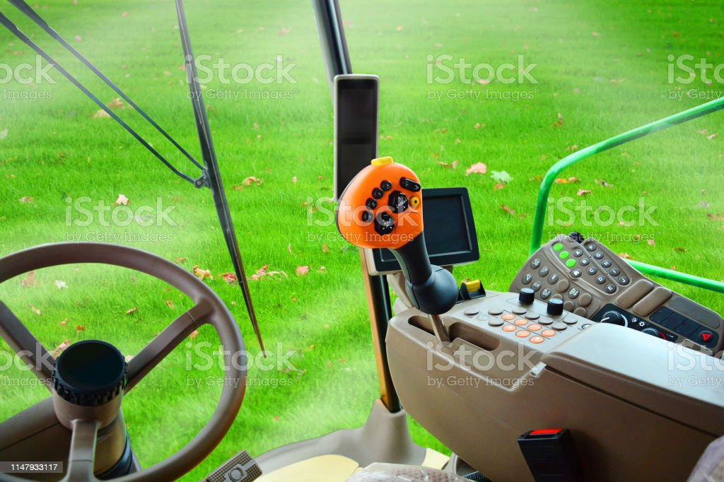 Interior of a combine harvester at work on a green ecological field....