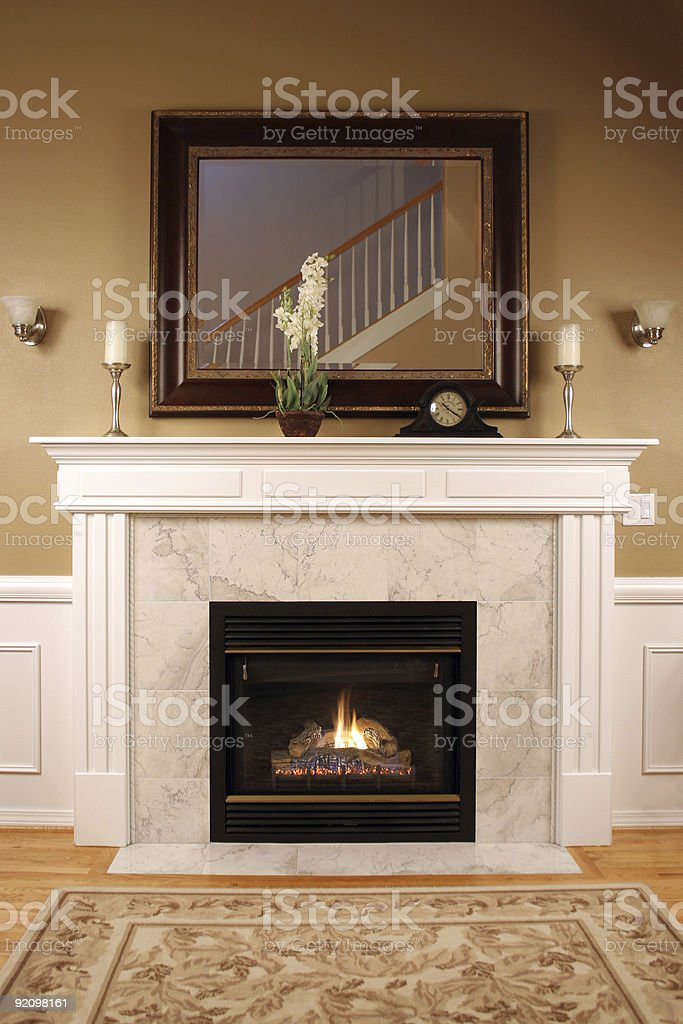 Interior of a cozy home with a fireplace and inviting colors stock photo
