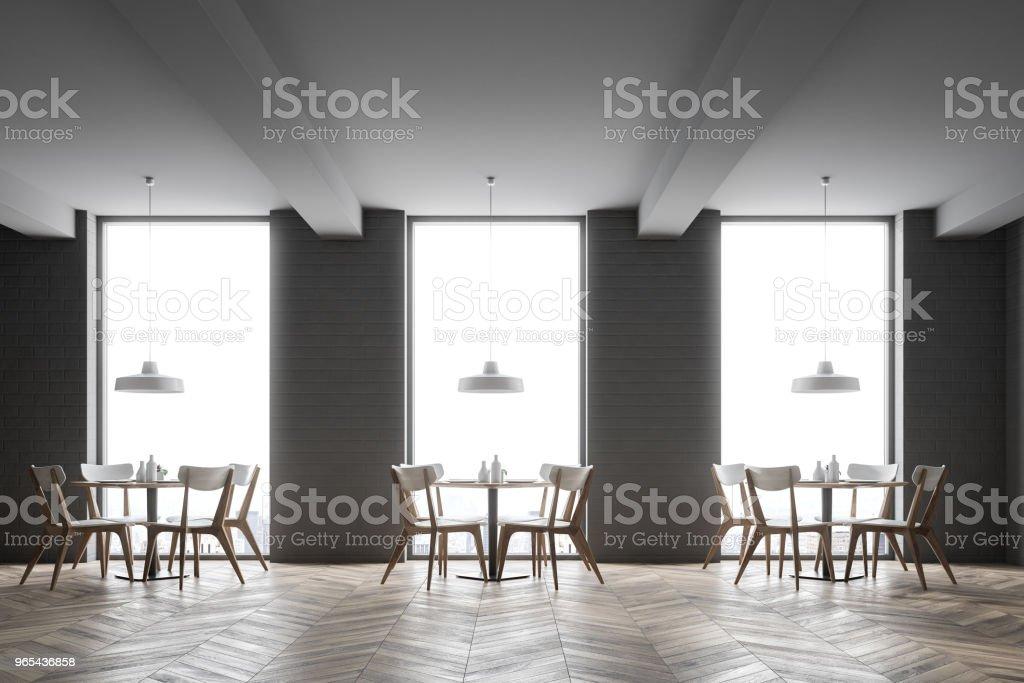 Interior of a gray brick loft cafe zbiór zdjęć royalty-free
