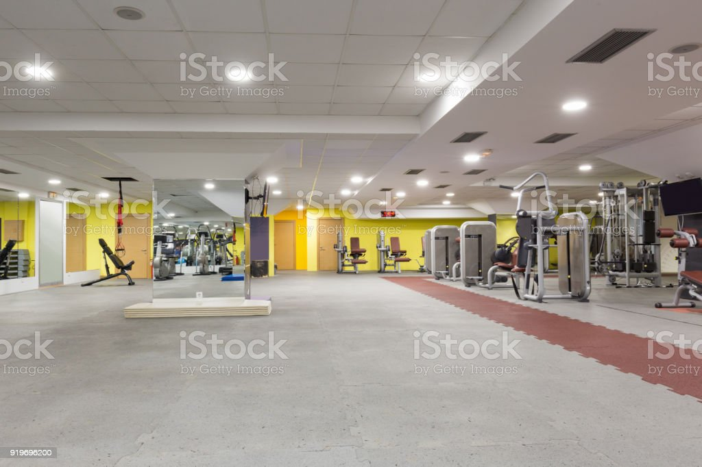 Interior of a gym with equipment stock photo