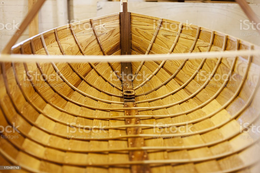 Interior of a handcrafted wooden rowing boat stock photo