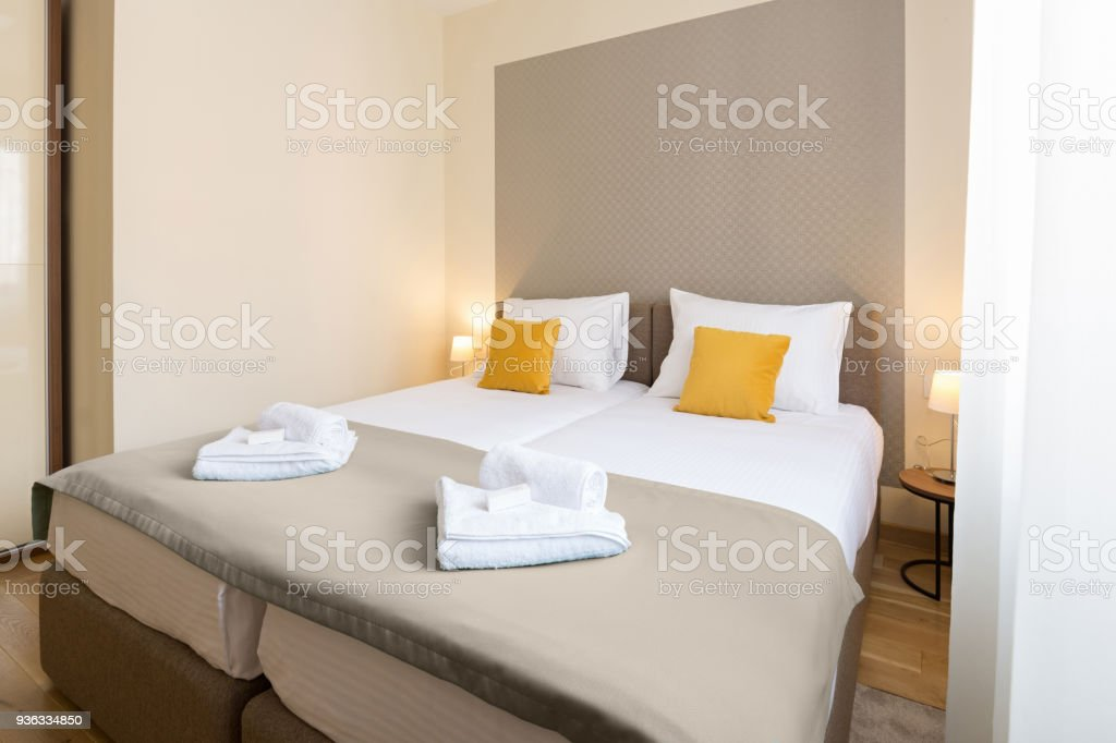 Interior of a hotel bedroom with double bed stock photo