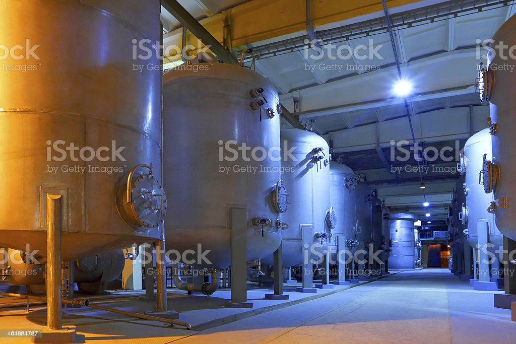 Interior of a huge chemical factory with giant tanks stock photo