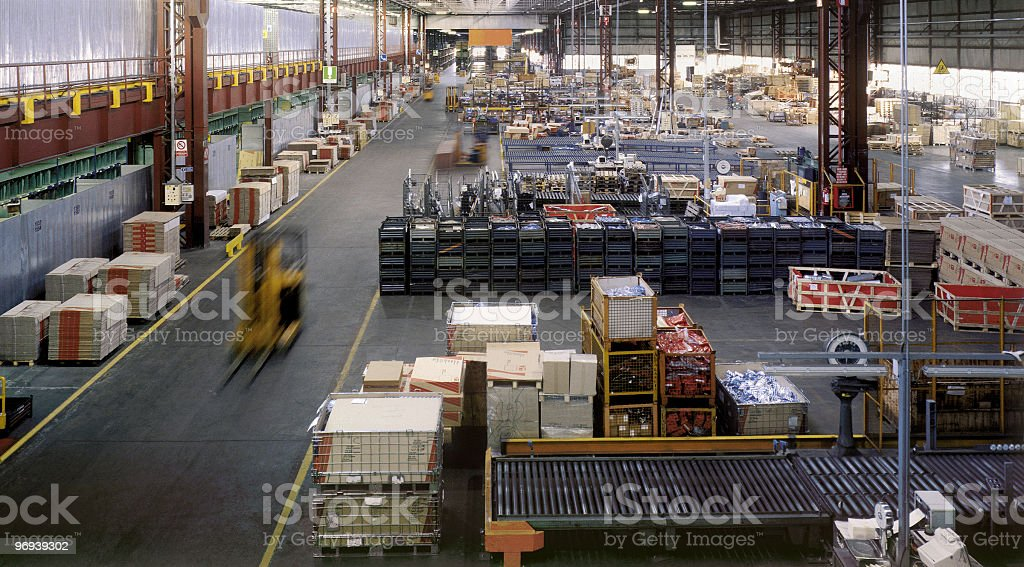 Interior of a huge industrial warehouse during a daywork royalty-free stock photo
