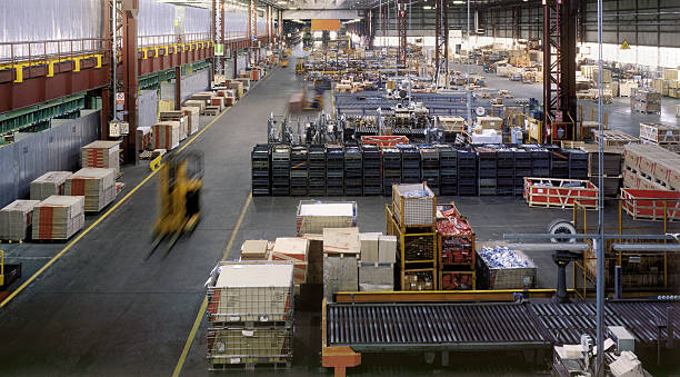 Interior of a huge industrial warehouse during a daywork stock photo