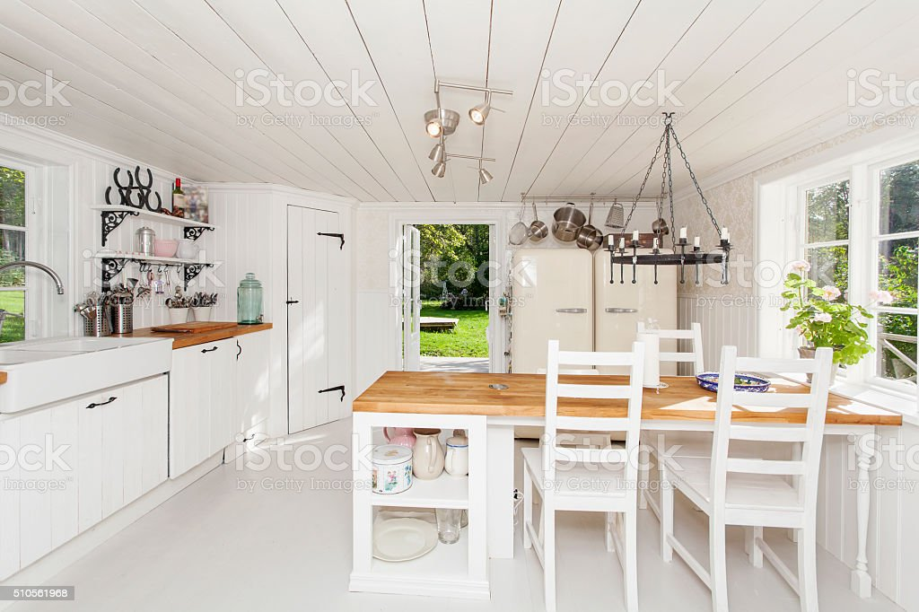 interior of a kitchen white wooden floor and ceiling stock photo