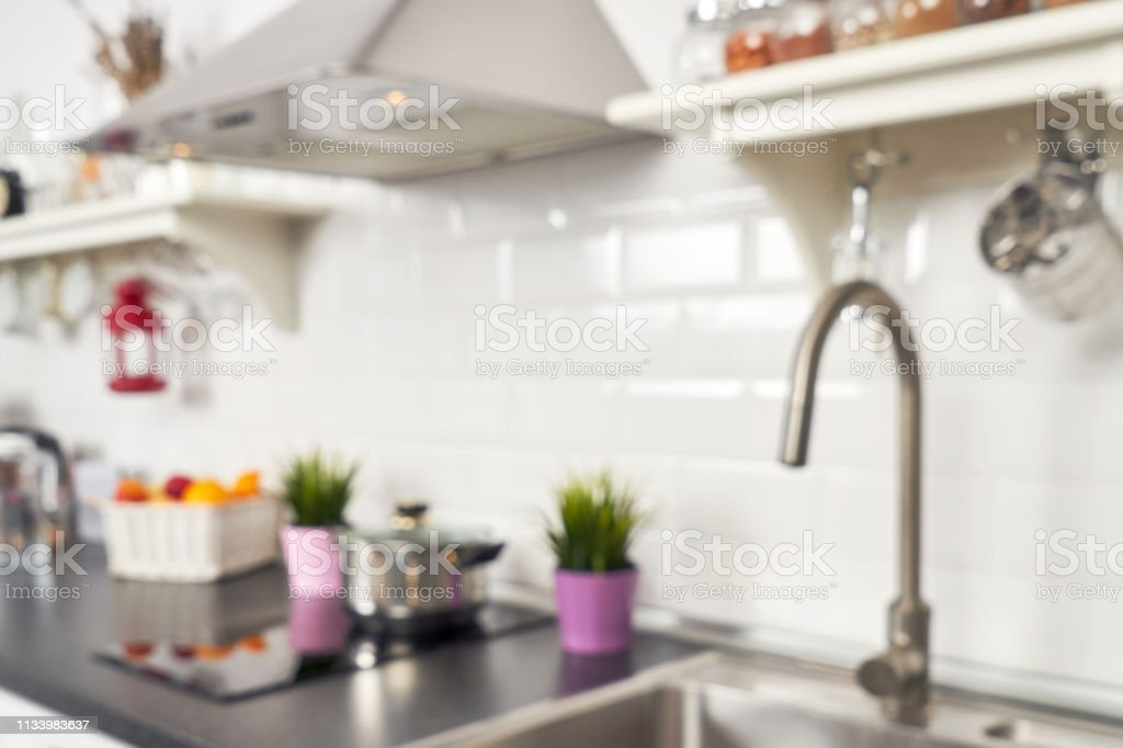 Interior Of A Light Kitchen In The Apartment Bright Home Interior Decoration Items Fruit Flowers In A Pot Steel Hood Bright Readymade Picture For Your Individual Design Stock Photo Download Image