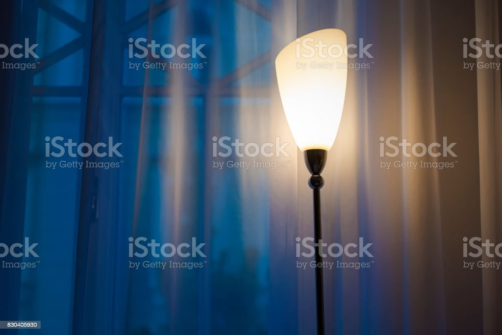 Interior of a living room, evening lamp in a room