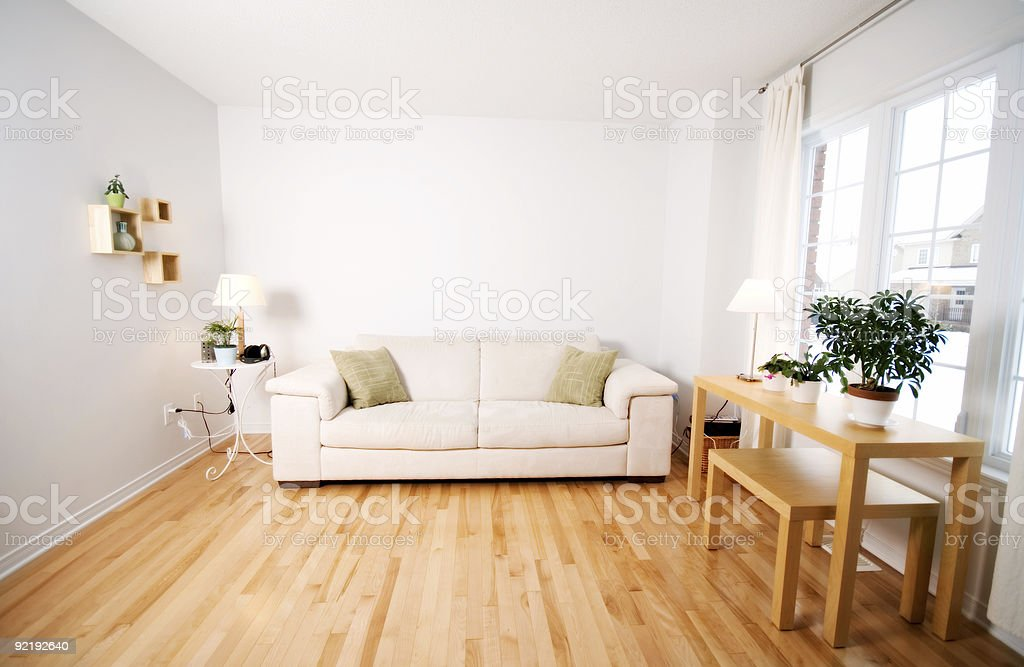 Interior of a living room with a wood floor royalty-free stock photo