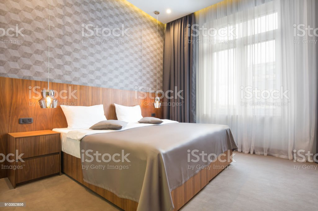 Interior of a luxury double bed hotel bedroom in the morning stock photo