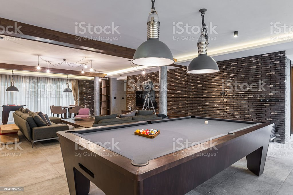 Interior of a luxury living room with billiard table stock photo
