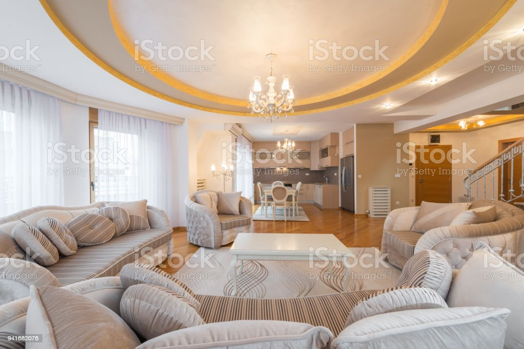 Interior of a luxury, open plan, apartment,living room with round, circle, ceiling, kitchen and dining area stock photo