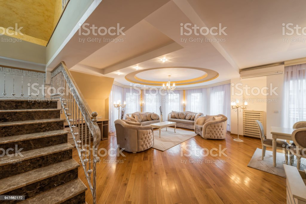 Interior of a luxury, open plan, living room with round, circle, ceiling stock photo