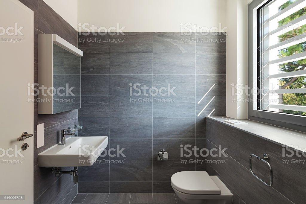 Interior of a modern house, gray bathroom stock photo