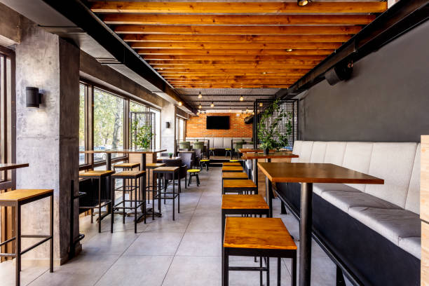 Interior of a modern industrial design pub Interior of a modern industrial design pub with a rustic twist coffee shop stock pictures, royalty-free photos & images