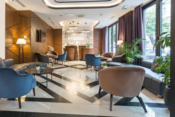 interior of a modern luxury hotel reception - hotel reception zdjęcia i obrazy z banku zdjęć