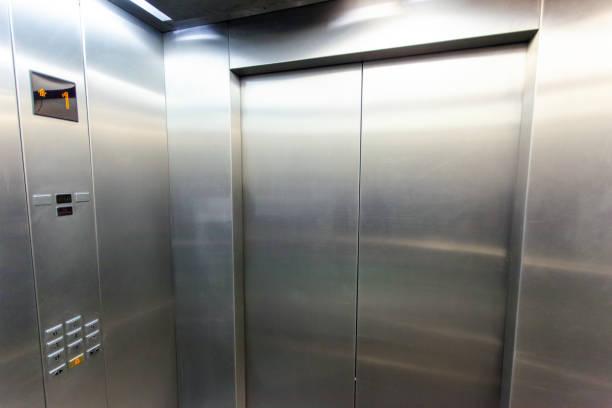 interior of a modern silvery elevator - ascensore foto e immagini stock