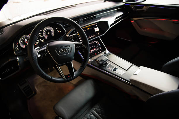 Interior of a premium sedan Audi A7 Sportback Ultra Nova GT 1 of 111. Black leather seats and dashboard, led screens with touchpads. climate control and shifters stock photo