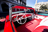 Interior of a red vintage car and view through the windshield, Havana, Cuba