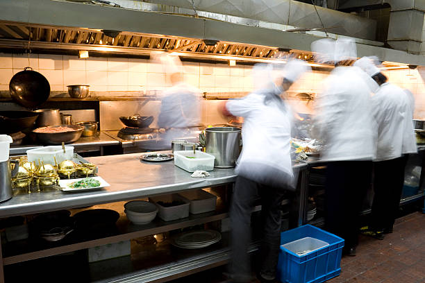 interior of a restaurant kitchen - busy restaurant kitchen stock pictures, royalty-free photos & images