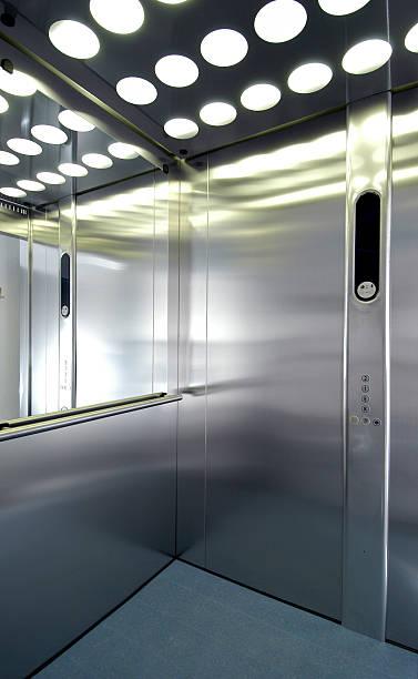 Interior of a silver German elevator called fahrstuhl stock photo