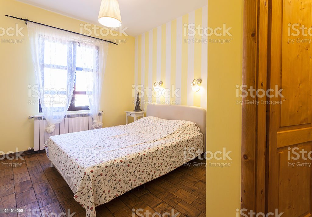 Picture of: Interior Of A Simple Bedroom With Yellow Walls Stock Photo Download Image Now Istock