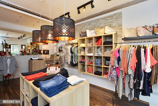 Interior shot of a fashion boutique. Selling women's clothes and accessories. Small business.