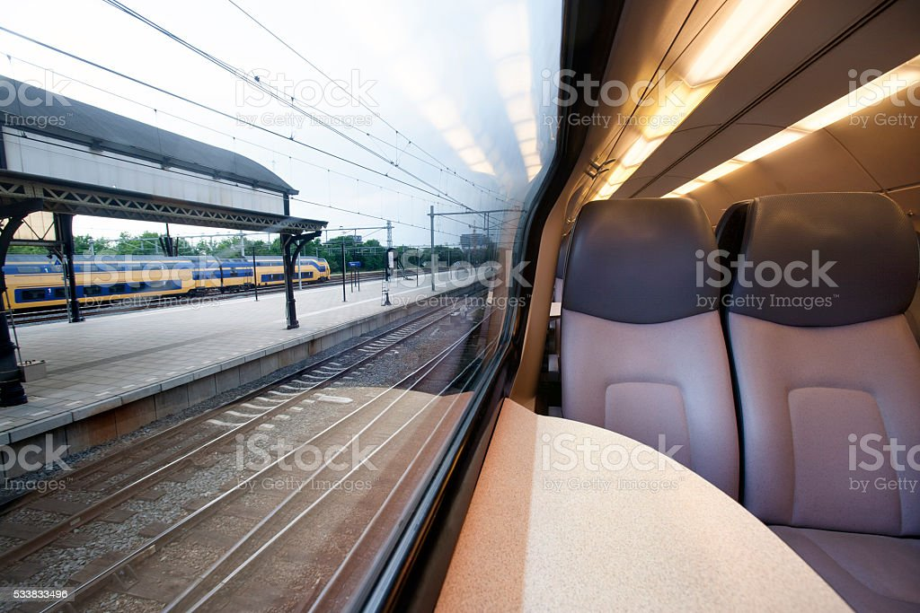 Interior of a train waiting at a station stock photo