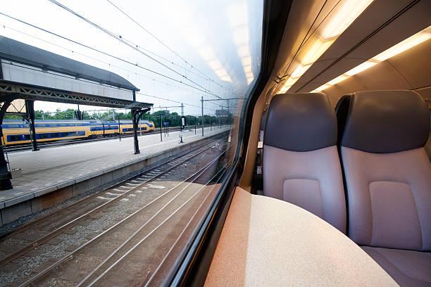 Interior of a train waiting at a station foto