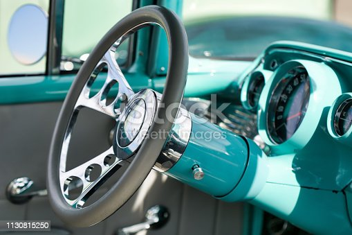 467735055 istock photo Interior of a turquoise classic American car 1130815250