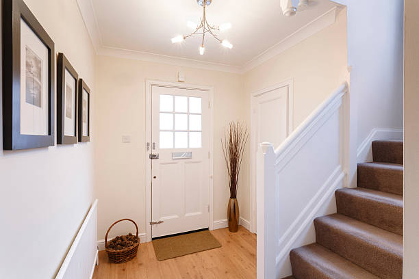 Interior of a white mudroom and carpeted stairs stock photo
