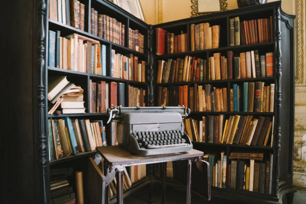Interior of abandoned ornate Colonial Villa with books and typewriter stock photo