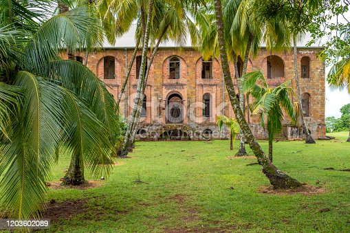 Interior of abandoned penal colony or jail on Salvation's Islands, taken on an overcast day with no people, French Guiana